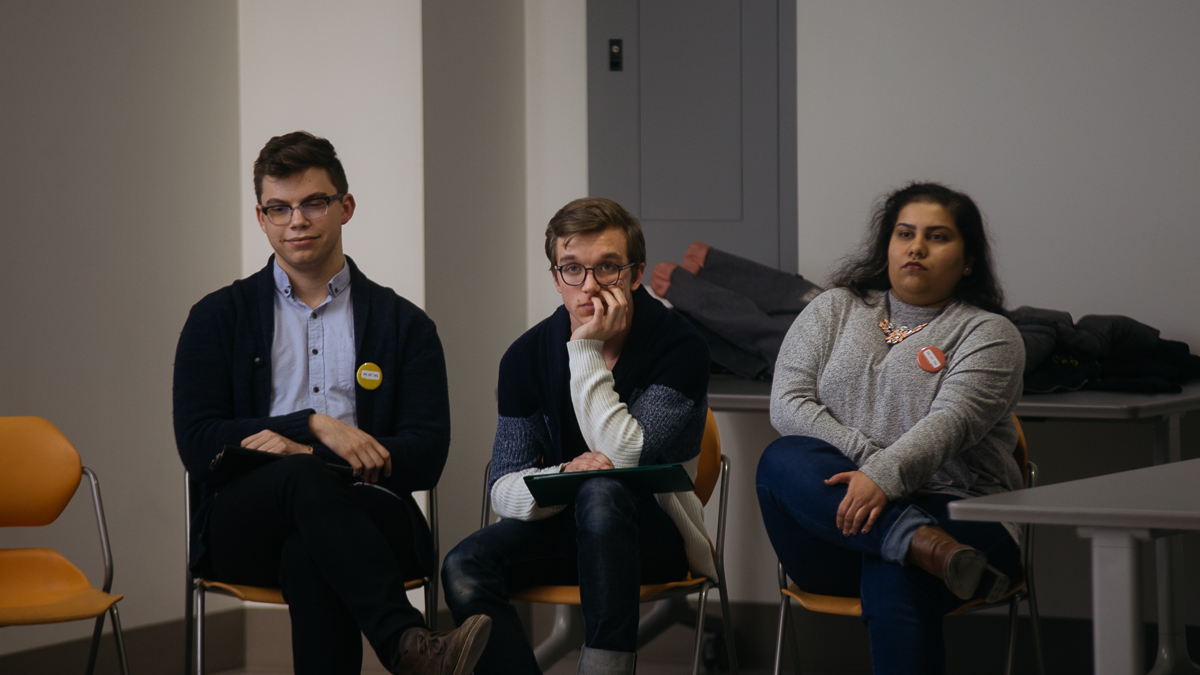 Photo of International students question candidates at ISA forum