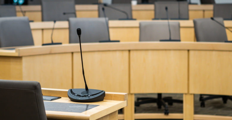 microphones and chairs in a council chamber
