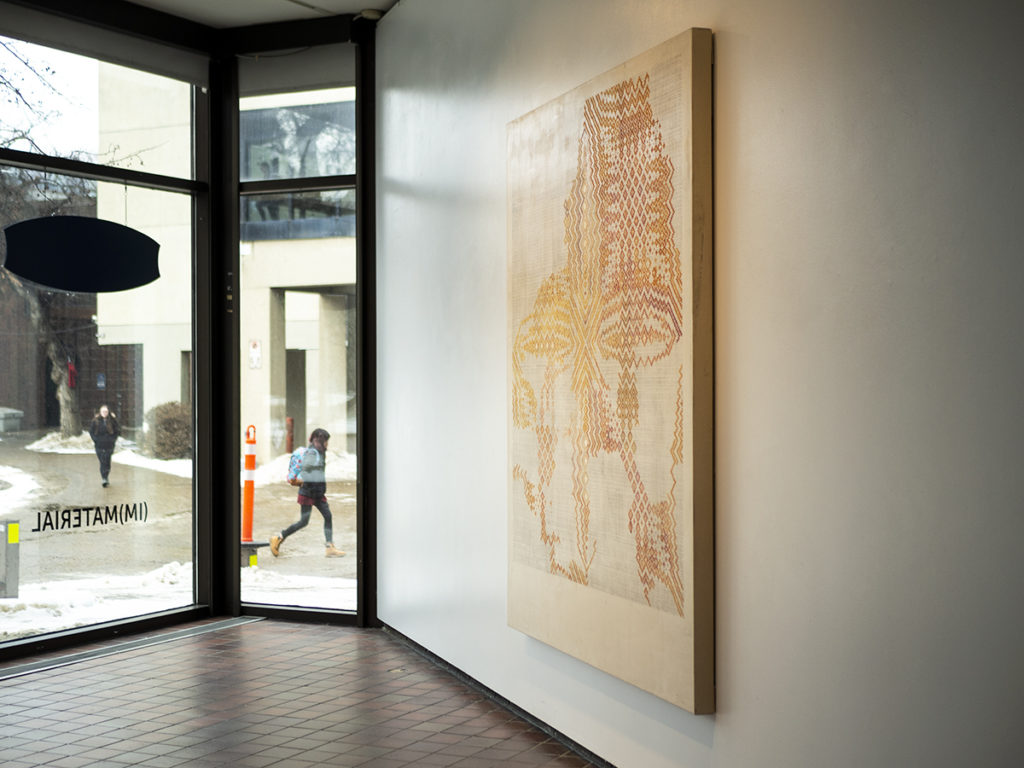 Kim McCollum big painting hanging on gallery wall