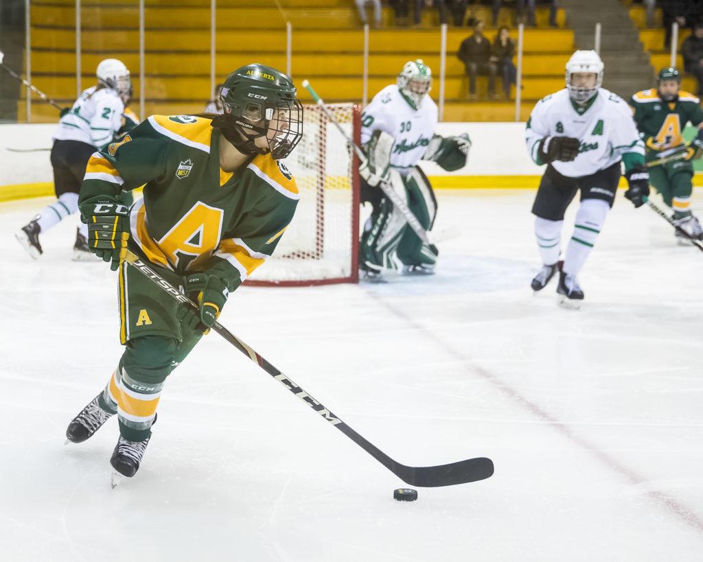 MacDougall playing hockey 2